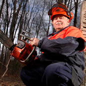 David Hardesty of the West Virginia Division of Forestry conducts a tree felling workshop in Flatwoods, WV.  Portrait Photogrpahy by Alex Wilson.