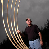 Marshall University sculpture professor Jonathan Cox with his sculpture The Idea at the 2005 Snowshoe Institute, at Snowshoe, WV.  Portrait Photogrpahy by Alex Wilson.